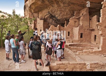 Colorado Mesa Verde National Park Spruce Tree House cliff dwelling ranger interpretive talk to visitors - Stock Photo