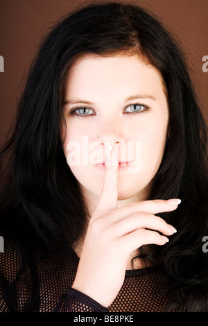 Woman, Gothic, dark-haired, face, finger, lips - Stock Photo