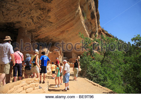 Visitors at the Spruce Tree House ruins in Mesa Verde National Park, Colorado, USA - Stock Photo