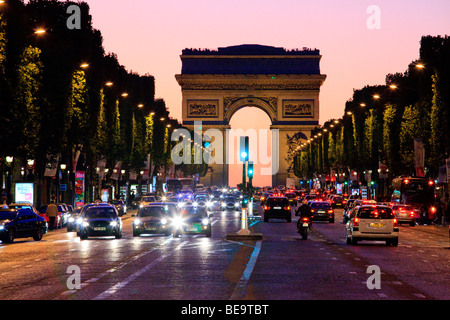 Arc de Triomphe and the Champs Elysees at night in Paris. - Stock Photo