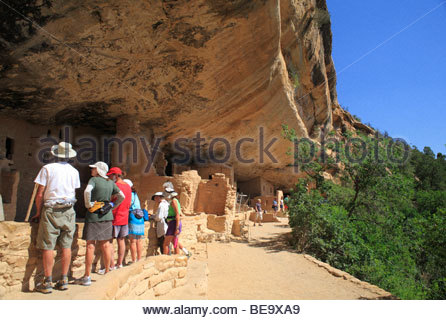 Visitors at the Spruce Tree House ruins at Mesa Verde National Park, Colorado, USA - Stock Photo