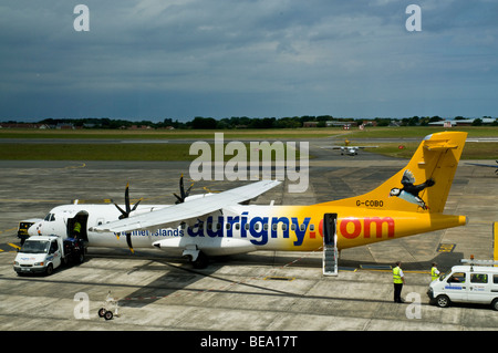 dh  AIRPORT GUERNSEY Aurigny channel islands ATR 72-500 twin turboprop passenger aircraft - Stock Photo