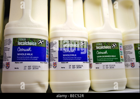 Milk in plastic bottles for sale in a Tesco supermarket in the United Kingdom - Stock Photo