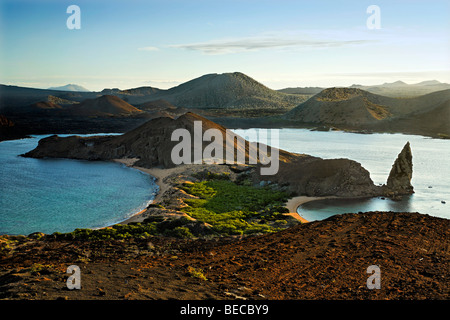 View to Sullivan Bay with beach, Pinnacle Rock and Santiago Island at horizon, Bartolomé Island, Galapagos Achipelago, - Stock Photo