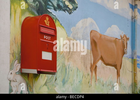 Postbox on a painted wall, Denmark - Stock Photo