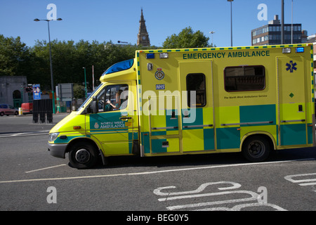 North West Ambulance service emergency ambulance at speed on the road in liverpool city centre merseyside england - Stock Photo