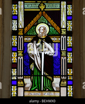 A stained glass window depicting St Paul the Apostle holding a sword and book, All Saints Church, Wighton, Norfolk - Stock Photo