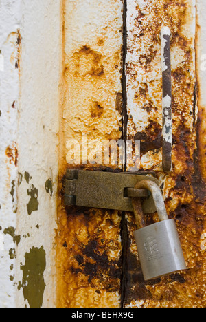 A lock on the rusty door of the Point Reyes lighthouse in California. - Stock Photo