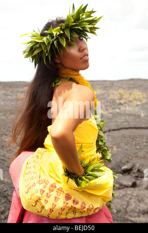 Young Hawaiian woman wearing traditional hula attire. - Stock Photo
