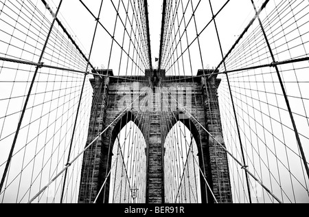 A tower and cables of the 'Brooklyn Bridge' in 'New York City,' 'New York.' - Stock Photo