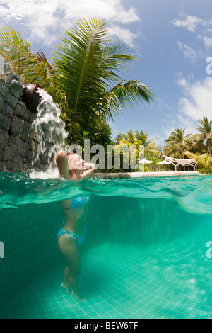 Woman in Swimming Pool, South Male Atoll, Maldives - Stock Photo