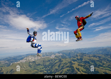 two people doing parachute jumping, full shot - Stock Photo