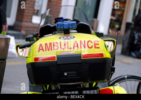 Ambulance sign printed on back of motor bike London England UK - Stock Photo