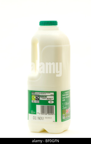Two Pints Of Semi Skimmed Milk In A Plastic Bottle Against a White Background - Stock Photo