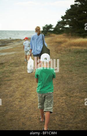 Mother and sons walking on a beach, Gotland, Sweden. - Stock Photo