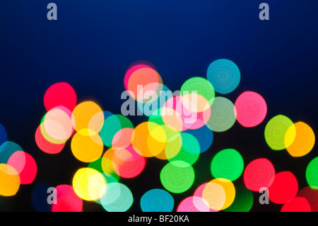 Out of focus multicolored Christmas light background - Stock Photo
