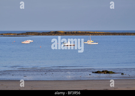 Low Newton-by-the-Sea, Northumberland. Exposed dolerite of the Great Whin Sill provides sheltered anchorage in Newton - Stock Photo