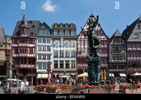Statue of Justice holding a scale in her hand on the Roemer, City Hall Square, Frankfurt am Main, Hesse, Germany, - Stock Photo