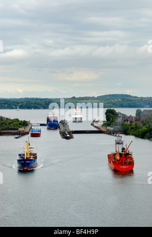 Shipping traffic on the Kiel-Canal, in the back the Schleuse Holtenau lock, Kiel, Schleswig-Holstein, Germany, Europe - Stock Photo