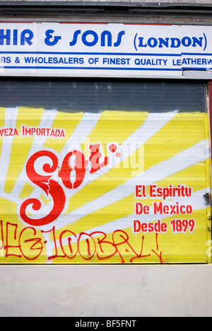SOL painting on the shutter, Brick Lane in East End, East London England UK - Stock Photo