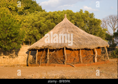 Traditional Zambian huts in Nsongwe village near Livingstone. - Stock Photo