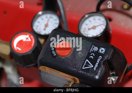 Air compressor gauge and controls - Stock Photo