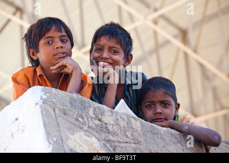 Boys at the camel racetrack in Pushkar in Rajasthan India - Stock Photo