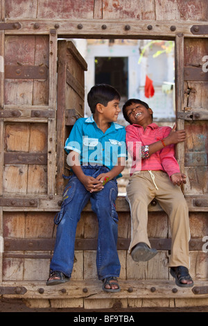 Boys in the entrance to a Haveli in Pushkar in Rajasthan India - Stock Photo