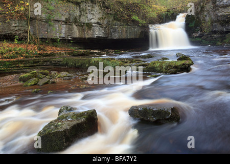 View of West Burton waterfall in a small village ot the same name in Wensleydale Yorkshire Dales National Park - Stock Photo
