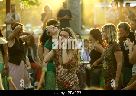 Women dancing to drums at The Channon near Byron Bay Australia - Stock Photo
