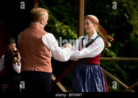 Folk Dancers and musician in traditional dress in Skansen Open Air Museum, Stockholm, Sweden - Stock Photo