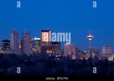 Skyline of Calgary, Alberta looking north with a view of the Calgary Tower on a clear night - Stock Photo