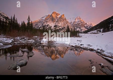 Mount Kidd at sunrise in the winter, Kananaskis Country, Alberta, Canada - Stock Photo