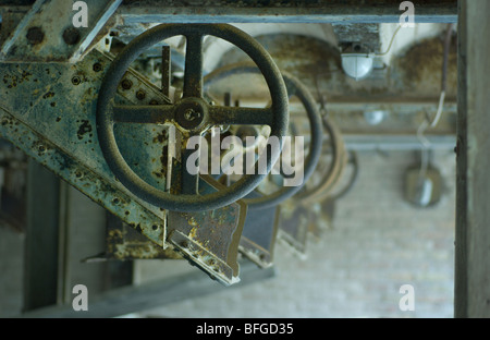 old iron wheels in a row - Stock Photo