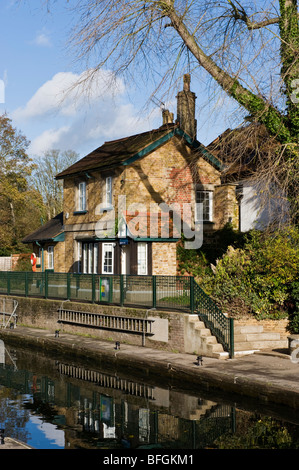 A traditional riverside lock keeper's cottage on Boulters Lock on the River Thames near Maidenhead Berkshire UK - Stock Photo