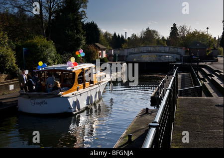 Boat adorned with party balloons at Boulters Lock on the River Thames near Maidenhead Berkshire UK - Stock Photo