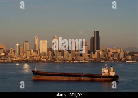 Seattle skyline from West Seattle with tankers in Elliott Bay at sunset with moonrise  Washington State USA - Stock Photo