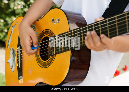 Little Boy Playing Guitar - Stock Photo