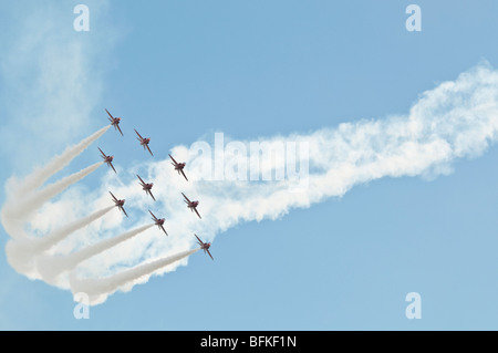 Red Arrows aerobatic team in diamond 9 formation. - Stock Photo