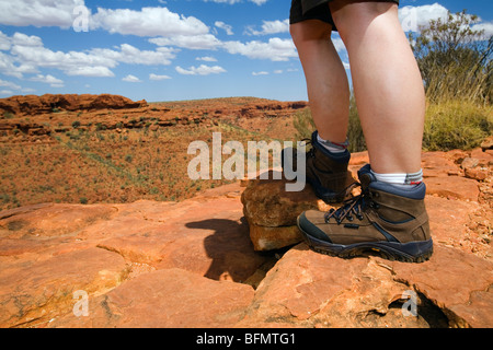 Australia, Northern Territory, Watarrka (Kings Canyon) National Park.  Hiker on the Kings Canyon rim walk. (MR) - Stock Photo