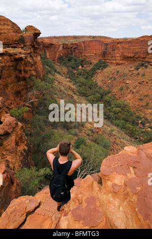 Australia, Northern Territory, Watarrka (Kings Canyon) National Park. A man looks out over Kings Canyon. (MR) (PR) - Stock Photo