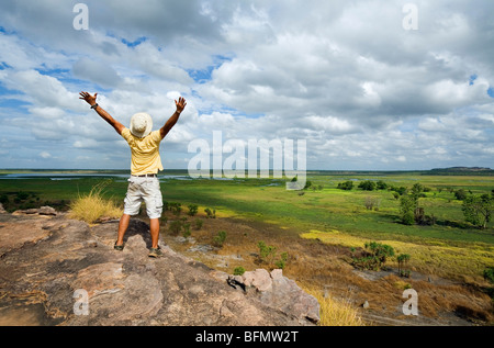 Australia, Northern Territory, Kakadu National Park. A tourist stands atop the Nadab escarpment at Ubirr. (MR) (PR) - Stock Photo