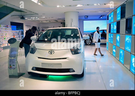 Paris, France, Man Shopping in New Car Showroom, Toyota Car, IQ, Hybrid Engine - Stock Photo