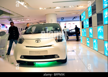 Paris, France, People Shopping in New Car Showroom, Toyota IQ, Gas Electric Hybrid Engine - Stock Photo