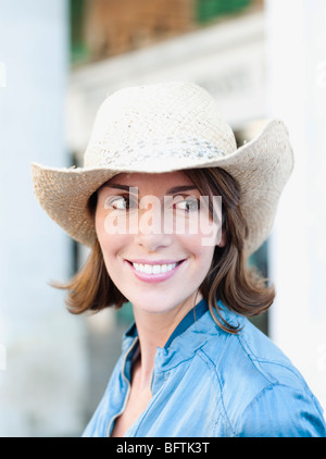 woman with hat smiling - Stock Photo