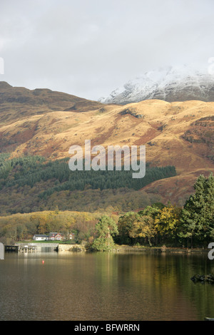 Area of Loch Lomond, Scotland. View of Loch Lomond at Rowardennan, with the snow covered peak of Ben Lomond in the - Stock Photo