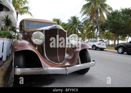 Vintage Car in Miami Beach Art Deco District Ocean Drive, Florida - Stock Photo