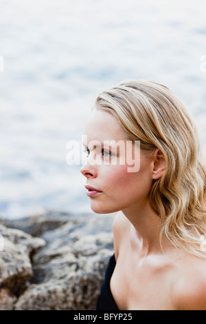 woman on the beach looking around - Stock Photo