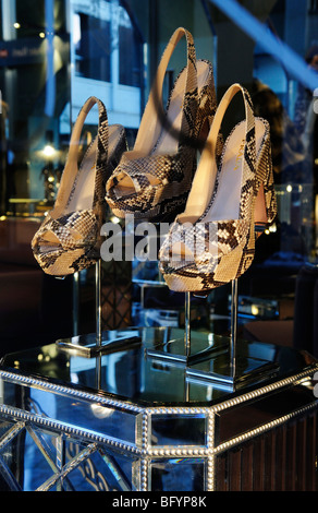 Snakeskin high-heeled shoes at a Prada boutique, St. Moritz, canton of Grisons, Switzerland, Europe - Stock Photo