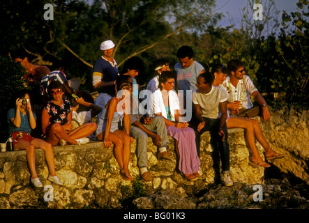 young adults, young men, young women, men, women, couples, on vacation, getting together, on beach, Negril, Jamaica - Stock Photo
